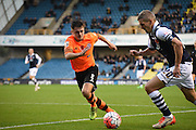 Casper Hughes looks to stop Steve Morrison's attack during the The FA Cup match between Millwall and Flyde at The Den, London, England on 7 November 2015. Photo by Michael Hulf.