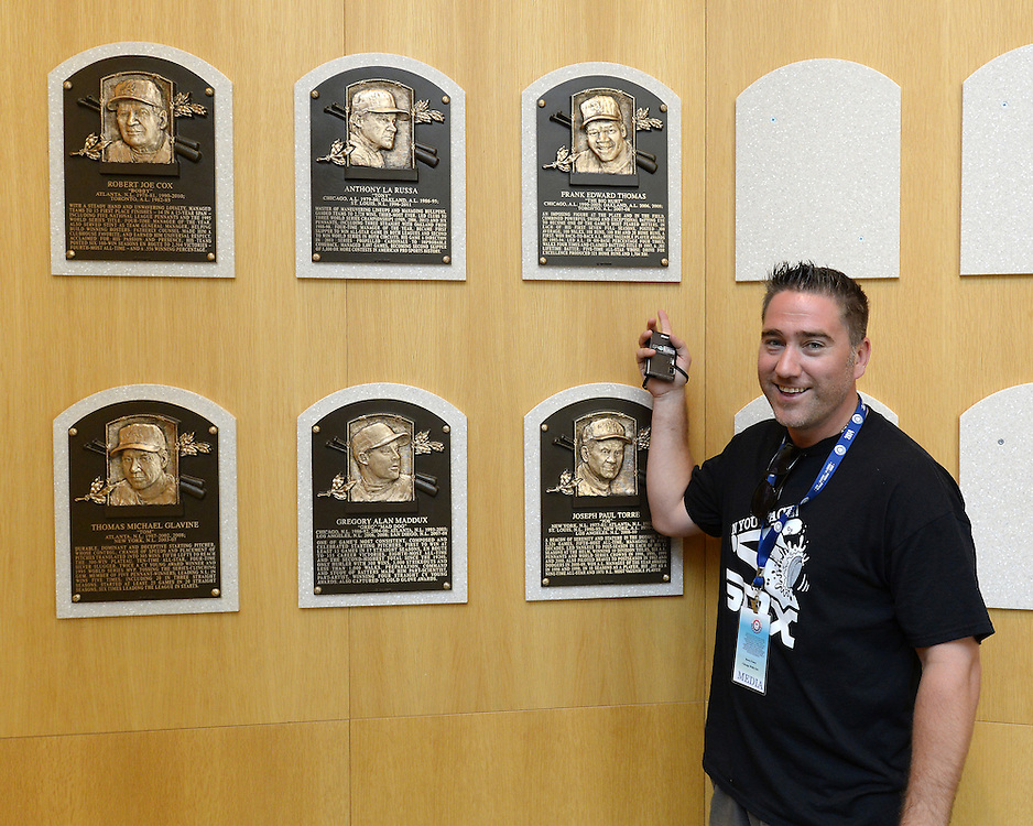 COOPERSTOWN, NY - JULY 28:  Rocco Fusco poses next to the plaque of 2014 Hall of Fame inductee Frank Thomas, on display at the Baseball Hall of Fame and Museum in Cooperstown, New York on July 28 2014.