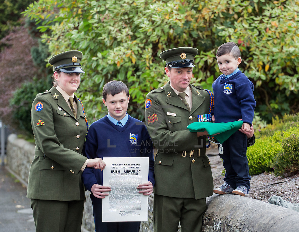 23/10/2015       <br /> Members of the Defence Forces were in Abbeyfeale today to present a handmade Tricolour and a copy of the Proclamation of the Irish Republic to students of the town's two primary schools.<br /> <br /> St Marys Boys National School and Scoil Mh&aacute;thair D&eacute; are among 3,000 schools nationally and 152 Limerick primary schools to receive the presentation as part of initiatives to mark the centenary of the 1916 Rising.&nbsp;<br /> <br /> Councillor Liam Galvin, Mayor of the City and County of Limerick joined pupils and teachers for today's presentation ceremony, which saw representatives of the Defences Forces raise the flag and read the Proclamation. <br /> <br /> Attending the ceremony at St. Marys Boys National School were, Private Ciara Quinn, Mark Roche, 12 and Sergeant James Reddan handing over the Tricolur to 4 year old pupil Dillon O'Brien. Picture: Alan Place.