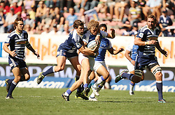 Nick Cummins of the Force is tackled by Danie Poolman of the Stormers with teammates Peter Grant and Andries Bekker in support during the Super Rugby (Super 15) fixture between DHL Stormers and the The Force played at DHL Newlands in Cape Town, South Africa on 26 March 2011. Photo by Jacques Rossouw/SPORTZPICS
