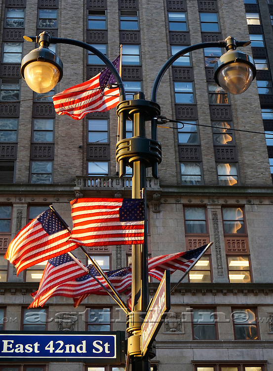Flags of U.S.A. on Manhattan street.