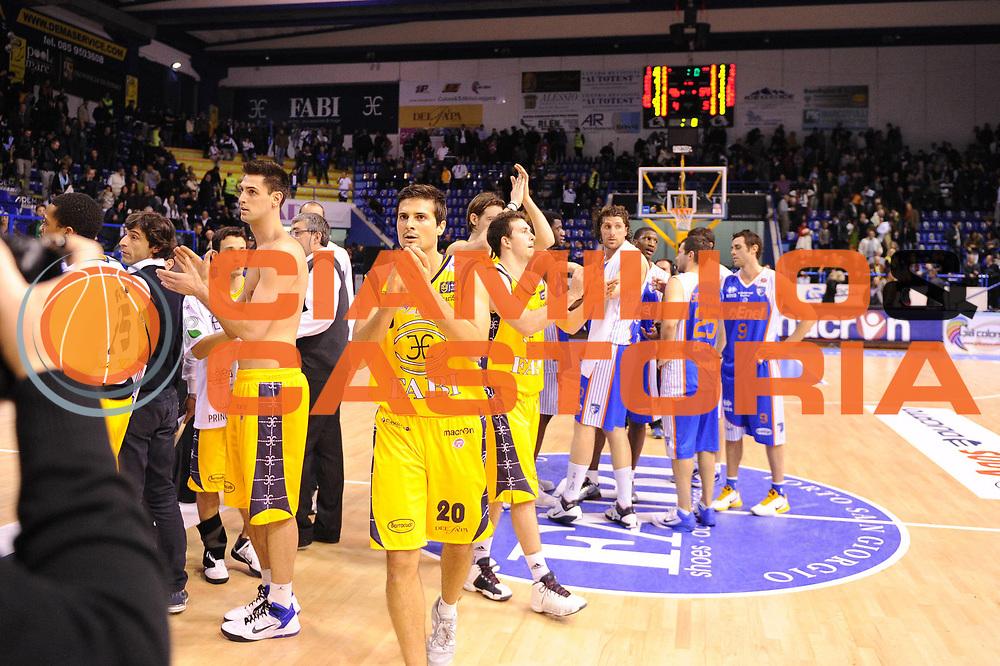 DESCRIZIONE : Porto San Giorgio Lega A 2010-11 Fabi Shoes Montegranaro Enel Brindisi<br /> GIOCATORE : team<br /> SQUADRA : Fabi Shoes Montegranaro<br /> EVENTO : Campionato Lega A 2010-2011<br /> GARA : Fabi Shoes Montegranaro Enel Brindisi<br /> DATA : 27/03/2011<br /> CATEGORIA : esultanza<br /> SPORT : Pallacanestro<br /> AUTORE : Agenzia Ciamillo-Castoria/C.De Massis<br /> Galleria : Lega Basket A 2010-2011<br /> Fotonotizia : Porto San Giorgio Lega A 2010-11 Fabi Shoes Montegranaro Enel Brindisi<br /> Predefinita :