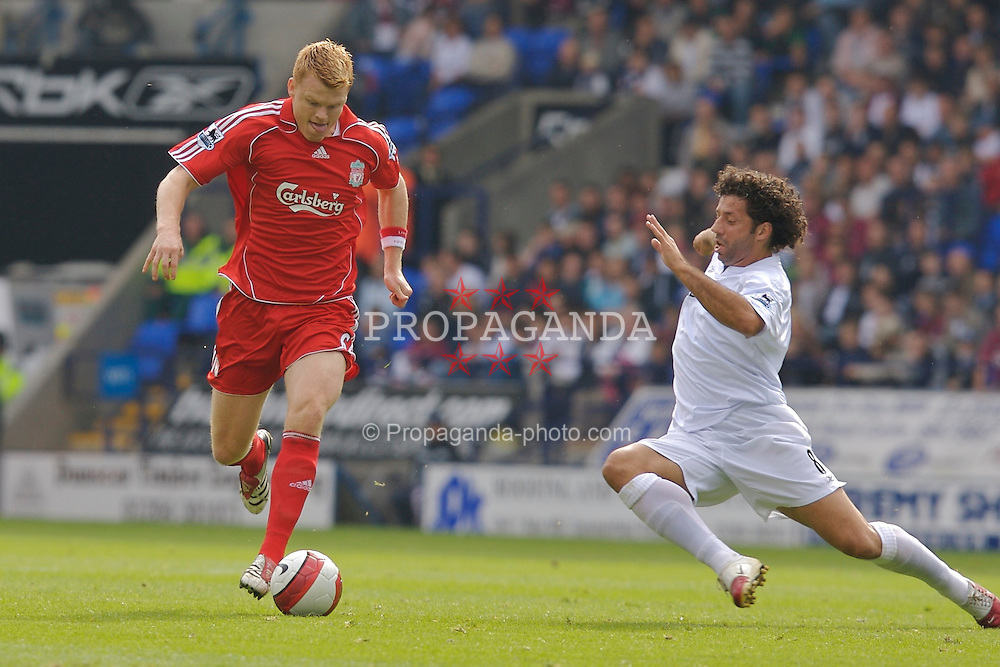 BOLTON, ENGLAND - SATURDAY, SEPTEMBER 30th , 2006: Liverpool's John Arne Riise is tackled by Bolton Wanderers' Ivan Campo during the Premiership match at the Reebok Stadium. (Pic by David Rawcliffe/Propaganda)