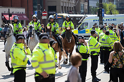 © Licensed to London News Pictures . 19/05/2018. Manchester, UK. Police from Merseyside and Lancashire forces are drafted in to support GMP as the Football Lads Alliance demonstrate in Manchester , three days before the first anniversary of the Manchester Arena terror attack . Photo credit: Joel Goodman/LNP