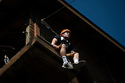 John Current waits to help people on the zipline at The Ridges on Parents Weekend. Photo by Hannah Ruhoff