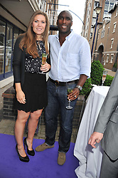 SOL CAMPBELL and his wife FIONA BARRETT at a party to celebrate the launch of Bentley's The Collection held at 6 Square Rigger Row, Plantation Wharf, York Road, London SW11 on 25th June 2012.