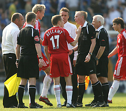 Portsmouth, England: Saturday, April 28, 2007: Liverpool's Craig Bellamy argues with referee Steve Bennett after the game against Portsmouth during the Premiership match at Fratton Park (Pic by Chris Ratcliffe/Propaganda)