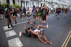 © Licensed to London News Pictures. 25/08/2019. London, UK. Revellers enjoy J'ouvert, a paint fight that officially marks the start of the Notting Hill carnival. The two day event is the second largest street festival in the world after the Rio Carnival in Brazil, attracting over 1 million people to the streets of West London. Photo credit: Ben Cawthra/LNP