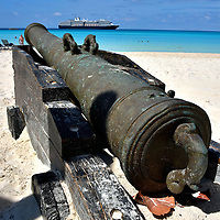 Old Pirate Cannon Replica at Half Moon Cay, Bahamas <br /> This is one of several cannons you will see at Half Moon Cay. They are reminiscent of those used by pirates who terrorized ships in The Bahamas from 1684 until 1718.  Although this rusty weapon is inactive, your children can enjoy a water-shooting cannon on a pirate ship at the Club HAL playground. Closer to the beach is the Lagoon Water Park.  Here the kids can have fun climbing on 21 water toys that are shaped like marine animals and cooling off on the waterslides.
