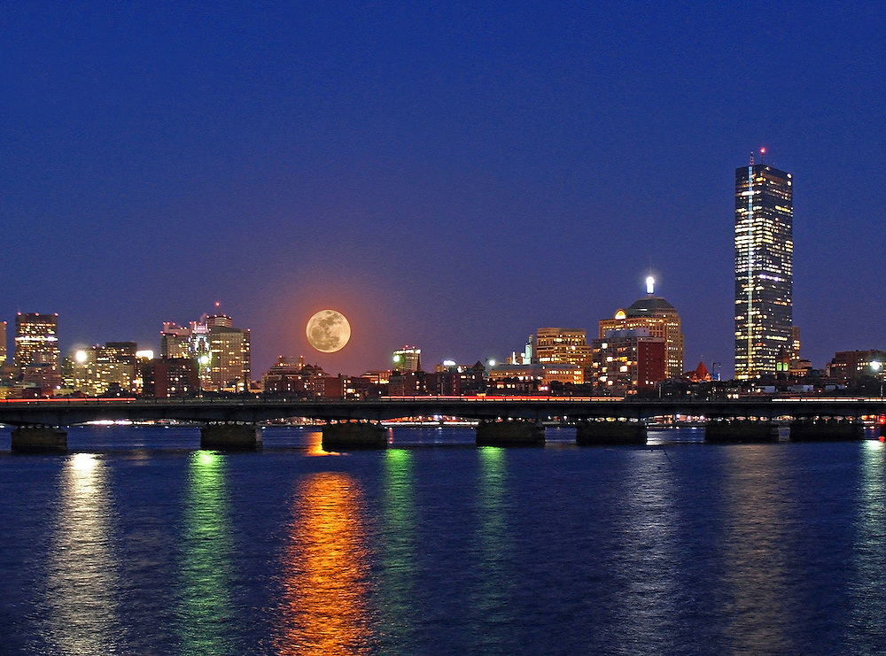 New England nature and astrology photography of the rising super moon over the Boston skyline with the full moon reflection in the Charles River. The full moon was quickly rising across the Boston Beacon Hill area and the Massachusetts Avenue bridge and making its way towards the John Hancock Tower. Boston nightscape and fullmoon are beautifully reflected in the Charles River while the magical blue twilight is still present. What a treat and pleasure to have experienced and photographed this astronomical phenomena. Next one up 14 November 2016.<br />