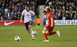 England's Alex Scott (Arsenal) under pressure from Wales's Helen Bleazard - Chelsea - Photo mandatory by-line: Robin White/JMP - Tel: Mobile: 07966 386802 26/10/2013 - SPORT - FOOTBALL - The Den - Millwall - England Women v Wales Women - World Cup Qualifier - Group 6
