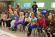 Students from Westfield Elementary School are surprised by the results of an experiment performed by Michelle Poe, Director of Education, during a workshop at the African American Museum of Iowa in Cedar Rapids on Friday, March 22, 2013.