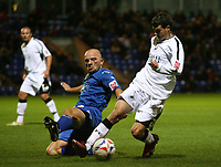 Photo: Rich Eaton.<br /> <br /> Peterborough United v Swansea City. Johnstone's Paint Trophy. 31/10/2006. Guy Branston left of Peterborough tackles Chris Jones of Swansea