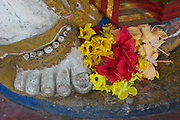 Detail of flowers at foot of a Lord Ganesh statue.