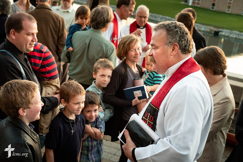 The Rev. Dr. Matthew Harrison, president of the LCMS, greets guests following The Order of Vespers with Distribution of Calls into the Holy Ministry on Wednesday, April 25, 2018, outside Kramer Chapel at Concordia Theological Seminary, Fort Wayne, Ind. LCMS Communications/Erik M. Lunsford