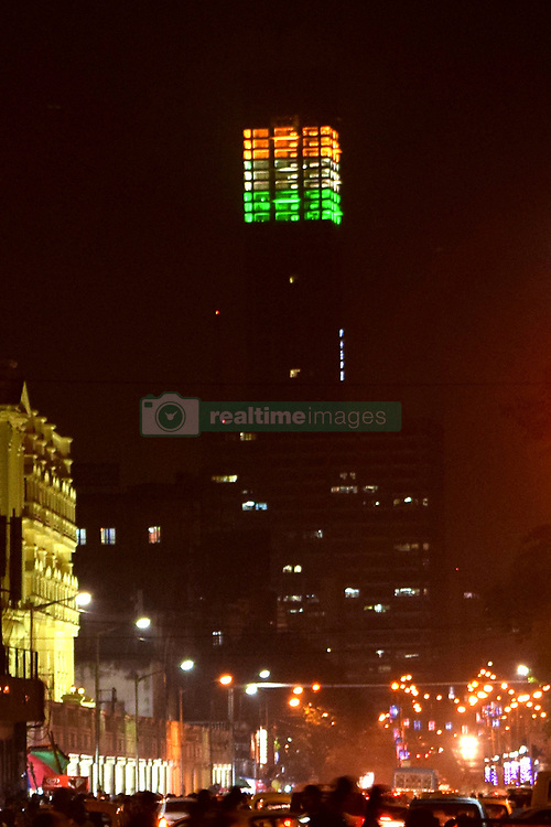 August 14, 2017 - Kolkata, West Bengal, India - Kolkata tallest The 42 building illuminated in tri colors on the eve of Independence Day. Building illuminated in tri colors on the eve of Independence Day on August 14, 2017 in Kolkata. (Credit Image: © Saikat Paul/Pacific Press via ZUMA Wire)