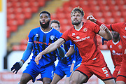 Ethan Ebanks-Landell and Jon Guthrie during the EFL Sky Bet League 1 match between Walsall and Rochdale at the Banks's Stadium, Walsall, England on 2 February 2019.