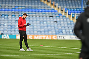 Sunderland Forward, Chris Maguire (7) check the pitch and programme before kick off during the EFL Sky Bet League 1 match between Portsmouth and Sunderland at Fratton Park, Portsmouth, England on 22 December 2018.