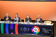 Versailles,  - November 16, 2018: <br /> Panelists (L-R) James McLaren, Martin Milton, Sébastien Candel and Barry Inglis celebrate after representatives from 57 countries voted unanimously to redefine four basic units of measurement -- the kilogram, the mole, the kelvin, and ampere -- during at the General Conference on Weights and Measures in Versailles, France November 16, 2018. <br /> <br /> CREDIT: Matt Roth for The New York Times<br /> Assignment ID: 30227070A