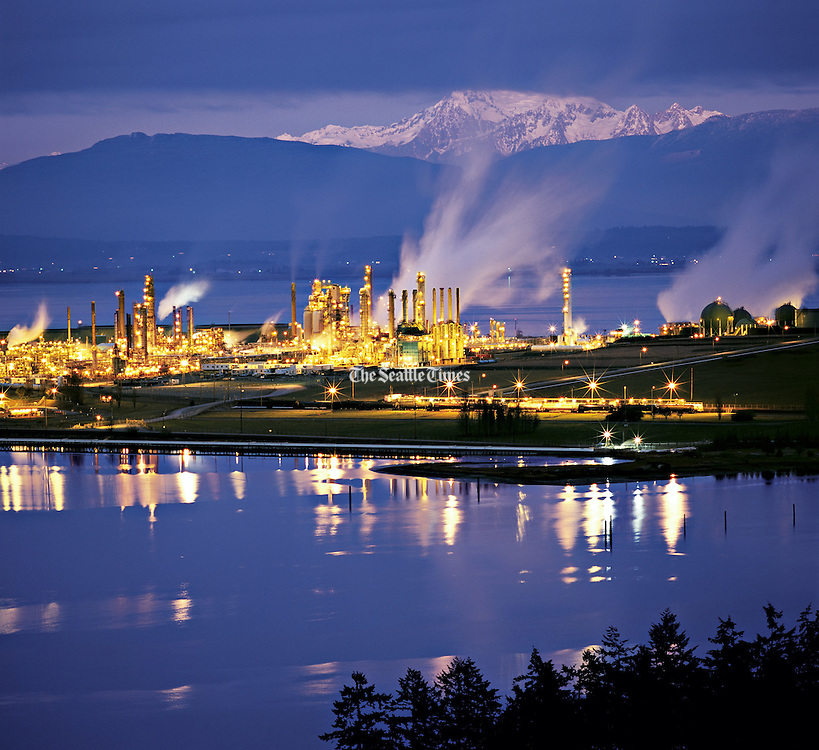 Anacortes' two oil refineries are an economic mainstay that sometimes provide ethereal industrial beauty. (Benjamin Benschneider / The Seattle Times)