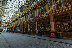 © Licensed to London News Pictures. 10/07/2020. CITY, UK.  A quiet Leadenhall Market in the City of London.  The historical market would normally be crowded with city workers on a Friday lunchtime but the coronavirus pandemic has left the venue largely unattended as people continue work from home.  The future definition of the workplace may be a hybrid of office work and working from home, resulting in a probable reduction in people working in the area.  Photo credit: Stephen Chung/LNP