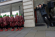 Dancers working for the UK company Hunter, perform a choreographed dance routine to officially launch the brand's flagship new store in London's Regent Street. Twenty Eight dancers stopped shoppers with their production of 'Singin' in the Rain.'
