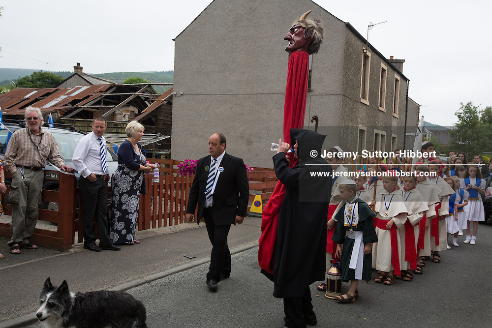 St. Ronan's Games, in Innerleithen, in the Borders, Scotland, Saturday 20th July 2013. Standard Bearer Lyle Caine, St Ronan Dux Boy Kieran Frost, Dux Girl Emily McNeill.