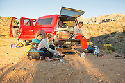Mayan Smith-Gobat and Ben Rueck cooking dinner in the Utah desert after a day climbing in the Utah Hills at The Cathedral