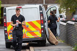 © Licensed to London News Pictures. 25/09/2019. Headington, UK. Forensic investigators gather evidence after two die in Oxford. Thames Valley Police were called to Foresters Tower in Wood Farm Road, Headington, at 21:18 BST on 24th September 2019 to reports that a man had fallen from an upper floor of Foresters Tower. The man died at the scene. <br /> Following a search of flats at Foresters Tower, a woman was located on the fourth floor with severe neck injuries and was pronounced dead at the scene.. Photo credit: Peter Manning/LNP