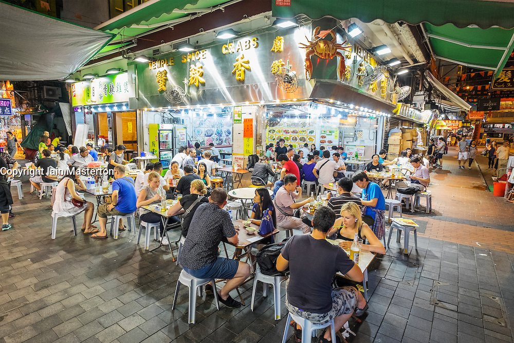 Busy seafood restaurant at temple Street night market in Kowloon Hong Kong