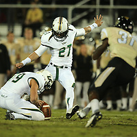 South Florida Bulls kicker Marvin Kloss (27) kicks a field goal during an NCAA football game between the South Florida Bulls and the 17th ranked University of Central Florida Knights at Bright House Networks Stadium on Friday, November 29, 2013 in Orlando, Florida. (AP Photo/Alex Menendez)