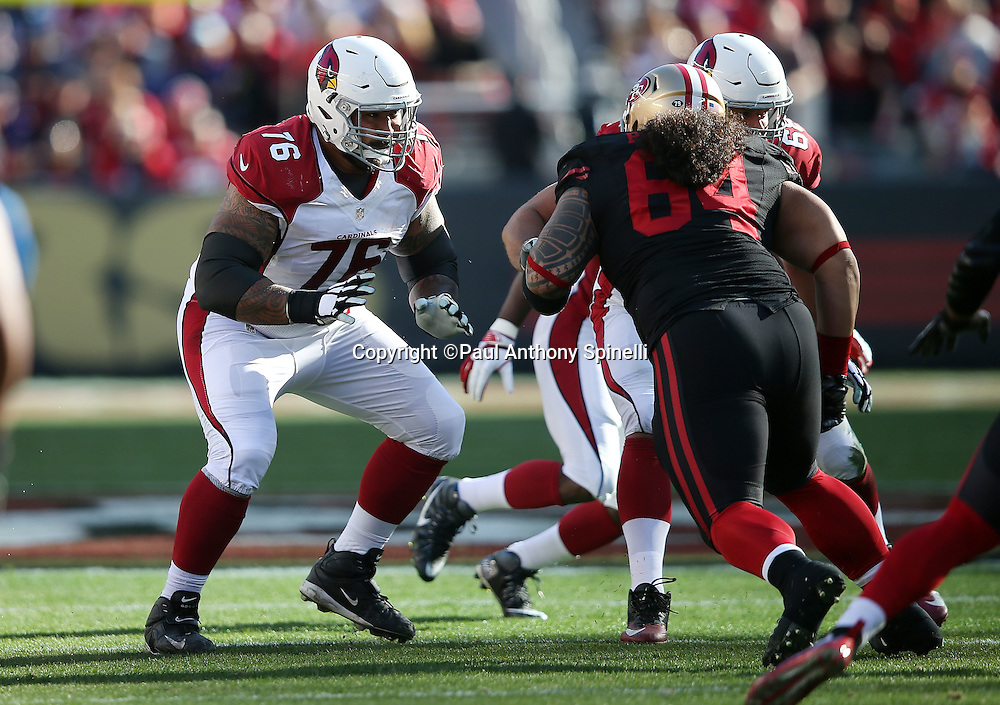 Arizona Cardinals guard Mike Iupati (76) blocks San Francisco 49ers nose tackle Mike Purcell (64) during the 2015 week 12 regular season NFL football game against the San Francisco 49ers on Sunday, Nov. 29, 2015 in Santa Clara, Calif. The Cardinals won the game 19-13. (©Paul Anthony Spinelli)
