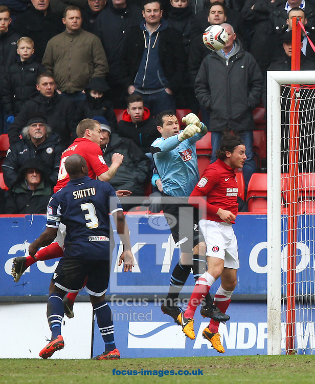 Picture by John  Rainford/Focus Images Ltd +44 7506 538356.16/03/2013.Lawrie Wilson of Charlton Athletic is beaten to a cross by the punch David Forde of Millwall during the npower Championship match at The Valley, London.