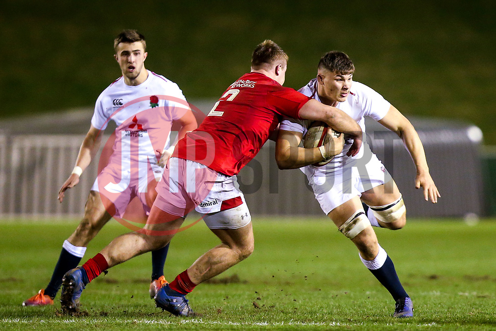 Aaron Hinkley of England U20 is tackled by Dewi Lake of Wales U20 - Mandatory by-line: Robbie Stephenson/JMP - 22/02/2019 - RUGBY - Zip World Stadium - Colwyn Bay, Wales - Wales U20 v England U20 - Under-20 Six Nations