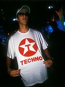 A man wearing a Texico 'Techno' T Shirt, Sao Paolo, Brazil, 2000's