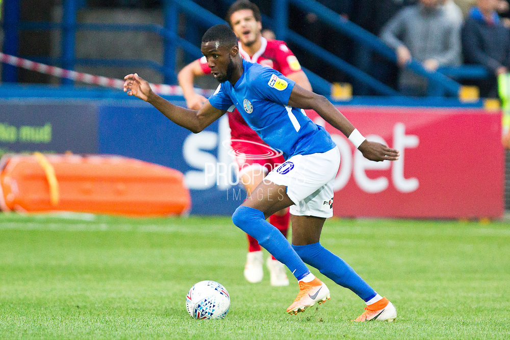 Macclesfield Town midfielder Emmanuel Osadebe in action during the EFL Sky Bet League 2 match between Macclesfield Town and Morecambe at Moss Rose, Macclesfield, United Kingdom on 20 August 2019.