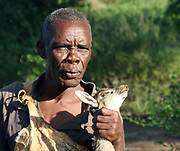 A Hadza hunter returns to the village with a his hunted prey. Photographed at Lake Eyasi, Tanzania