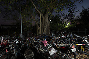 Motorbikes piled up rot away in Bangkok's 'car cemetery'. <br /> <br /> According to a 2014 study by the University of Michigan&rsquo;s Transportation Research Institute Thailand ranks number 2 in the world for road fatalities, narrowly second only to Namibia. The report found a frightening 44 road deaths were recorded per 10,000 population. The high accident rate is often attributed to reckless driving, including driving while intoxicated, and lack of safety precautions such as wearing a helmet on motorbikes. A WHO report indicated that 26 percent of road deaths in Thailand involve alcohol.<br /> <br /> The sheer number of crashed vehicles is so high that police now hold auctions to sell off the vehicles, either not wanted by their owner or beyond repair, and it has become a good business. But the auctions are a relatively new phenomenon where previously cars would be kept at police stations until the legal case is complete and then deposited at a collection site.<br /> <br /> On the outskirts of Bangkok in a scruffy suburb is one such depository. Dubbed &lsquo;the car cemetery&rsquo; by locals it was where many of Bangkok&rsquo;s damaged wrecks would end up if no-one else wanted to them. But the site has also taken on another reputation; that of being one of the most haunted places in the city, third to be precise according to a local TV station. Thai&rsquo;s are very superstitious people and most believe in ghosts or spirits. Here it was believed that the spirits of those killed in the crashes remained with the vehicles they died in. Many a passerby or taxi driver have stories of people in and around the compound who then simply vanishing. Locals became so frightened of the place that a group of Thai Buddhist monks from a nearby temple were invited in to perform a ritual exorcism to release the spirits.<br /> <br /> With most crashed cars now being bought at the auctions the car cemetery doesn&rsquo;t receive new vehicles anymore but many of the old ones remain s