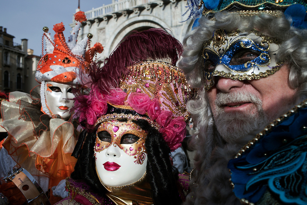 A Carnival Maskes poses in San Marco square in Venice during the carnival.