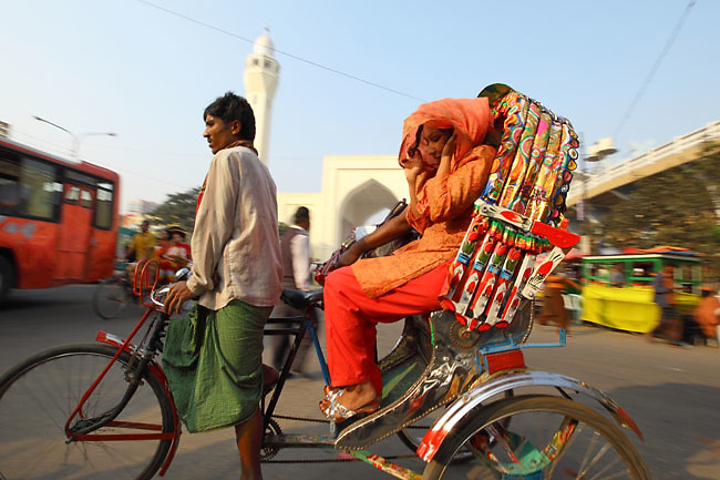 Rickshaw in the crowded traffic of Old Dhaka (Dhaka, Bangladesh).