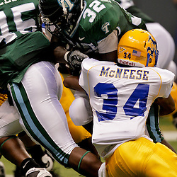 Sep 26, 2009; New Orleans, LA, USA; Tulane Green Wave running back Andre Anderson (32) is tackled by McNesse State Cowboys safety Malcolm Bronson (34) at the Louisiana Superdome. Tulane defeated McNeese State 42-32. Mandatory Credit: Derick E. Hingle-US PRESSWIRE