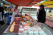 France, Paris, an outdoor, street food market a butcher