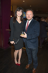 Author and screenwriter JOHN NIVEN and DAISY LOWE at the Al Films and Warner Music Screening of Kill Your Friends held at the Curzon Soho Cinema, 99 Shaftesbury Avenue, London on 27th October 2015.
