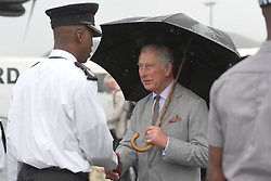 The Prince of Wales talks with an emergency worker as he arrives for a visit to the island of Tortola, in the British Virgin Islands as he continues his tour of hurricane-ravaged Caribbean islands.