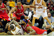 Feb. 11, 2011; Cleveland, OH, USA; Cleveland Cavaliers point guard Mo Williams (2) tries to keep a loose ball from Los Angeles Clippers guard Randy Foye (4) and point guard Baron Davis (5) during overtime at Quicken Loans Arena. The Cavaliers broke their loosing streak beating the Clipper 126-119 in overtime. Mandatory Credit: Jason Miller-US PRESSWIRE