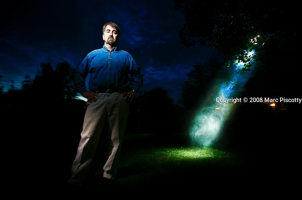 """SHOT 5/23/08 8:47:13 PM - Portraits of Stan Romanek, 45, of Loveland, Co. who claims to have experienced and even documented more than 100 extraterrestrial encounters in his lifetime. Since December 2000 Romanek said he has been abducted numerous times and been the conduit for complex mathematical equations that he doesn't even understand. Romanek said he understands that there are skeptics out there and added, """"I'm not the only one to go through this and most people don't want to talk about it because of the ridicule, I just want to be taken seriously"""". He has attempted to use mainstream science to study the experiences and a non-fiction book and documentary are in the works about his life. .(Photo by Marc Piscotty / © 2008)"""