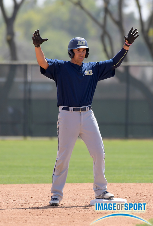 Cal State Monterey Bay Otters outfielder Darren Kritz celebrates after hitting a double during an NCAA College baseball game against the Cal  Poly Pomona Broncos in Pomona, Calif., Friday, April 13, 2018.