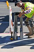Worker at Tugo Bike Share's Rio Nuevo Station installation.
