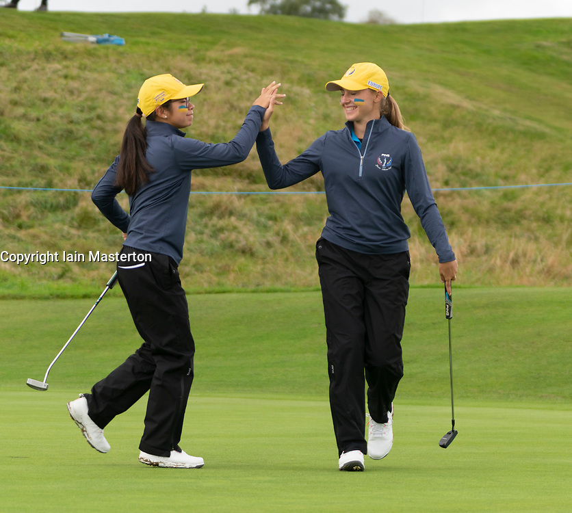 Auchterarder, Scotland, UK. 10 September 2019. Day one of the Junior Solheim Cup 2019 at the Centenary Course at Gleneagles. Tuesday Morning Foursomes. Pictured Lilas Pinthier (l) and Paula Schulz-Hanssen of Europe celebrate a putt to win hole. Iain Masterton/Alamy Live News