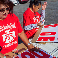 Marie Acothley, left, and Juanita Begay make protest signs during a protest against the Department of Diné Education in Window Rock Thursday. Protesters argued that DODE was mismanaging Navajo Nation Schools and they called for the removal of the superintendent.